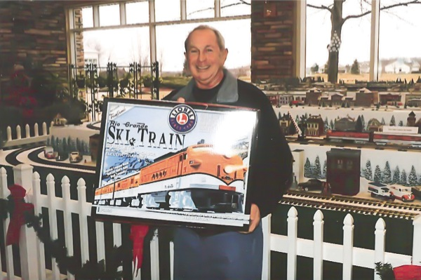 Caesar Baldacci, a winner of one of the three Rio Grande Ski Train sets, poses with his prize. Baldacci plans to give the set to his grandson. (Photo provided)