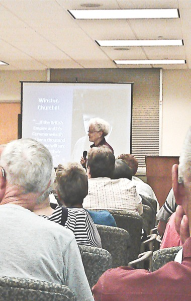 WWII survivor Joy Aavang (standing) shares her experiences with the Sun City's Historians Club. (Photo by Mason Souza/Sun Day)