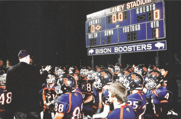 Sun City resident and former Buffalo Grove head footbal coach Grant Blaney stands and speaks to the Buffalo Grove varsity football team during the night the stadium is honored with his name on Sept. 23, 2011. (Photo provided)