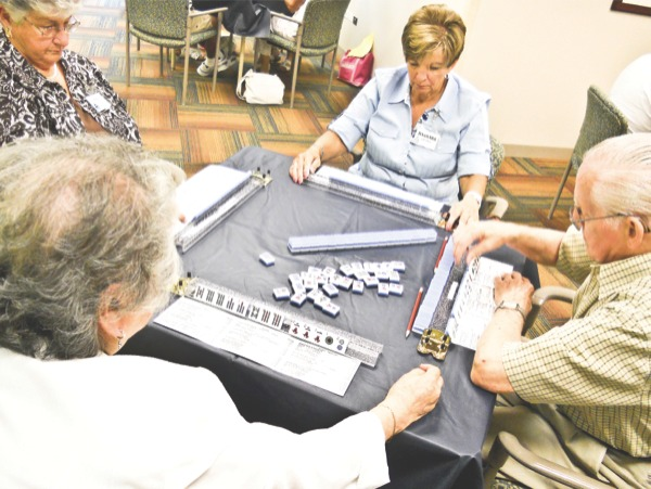 Members of the Mah-Jongg club of Sun City play a game during the annual tournament on June 28. (Photo by Marek Makowski/Sun Day)