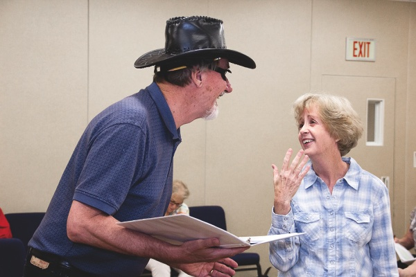 Red Velvet Cake War cast members Dick Storer and Diane Scott execute a scene at rehearsals. (Photo by Tony Pratt/Sun Day)