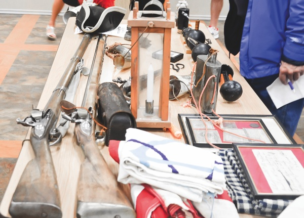 Items used in the Revolutionary War on display, during presentation. (Photo by Christine Such/Sun Day)