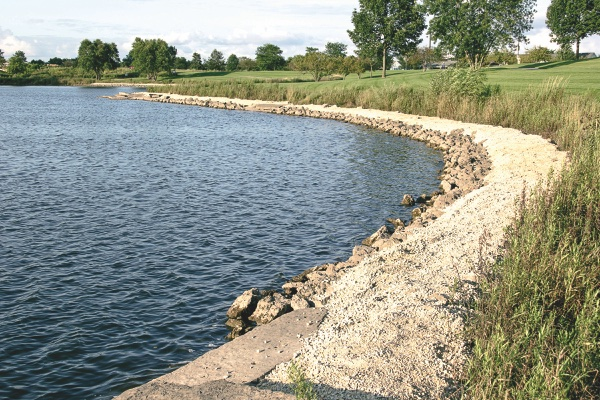 Shown here is the shoreline covered in a gravel called fines, which hardens quickly and handles well against ero- sion or submersion. It also provides a stable walking path. (Photo by Tony Pratt/Sun Day)