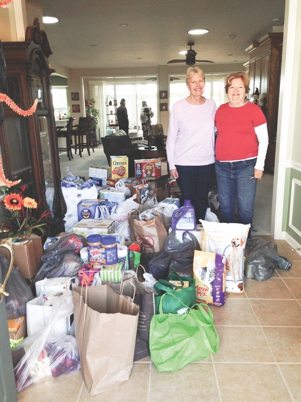 Laurie Larkin (left) and Annalee Boles before a previous successful food drive. (Photos provided)