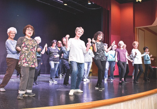 Female cast performs a dance routine at a recent rehearsal.