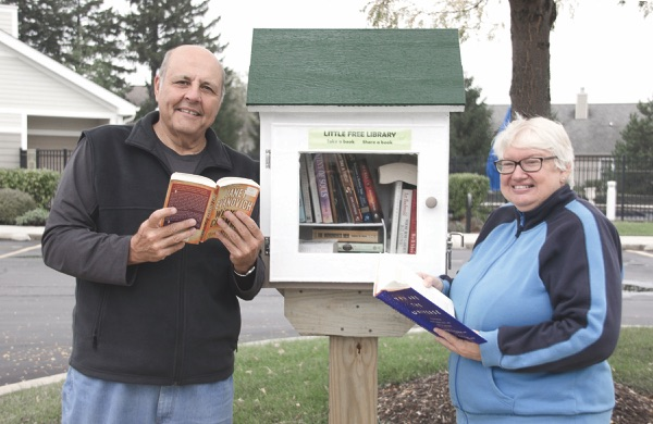Vito and Linda Benigno will be stewards of this Little Library near the Meadow View outdoor swimming pool in Sun City. (Photo by Tony Pratt/Sun Day)
