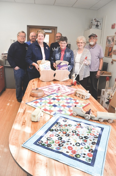 Sew n Sews and Woodchucks collaborate on holiday project donations. (Photo by Christine Such/Sun Day)