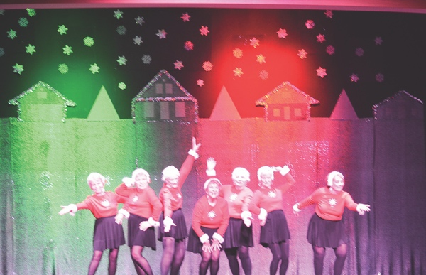 Strutters performing Feliz Navidad.