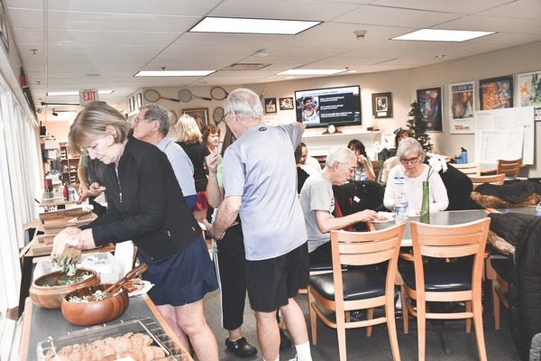 Tall Oaks Tennis Club members enjoy food and festivities at their annual social. (Photo by Christine Such/Sun Day)