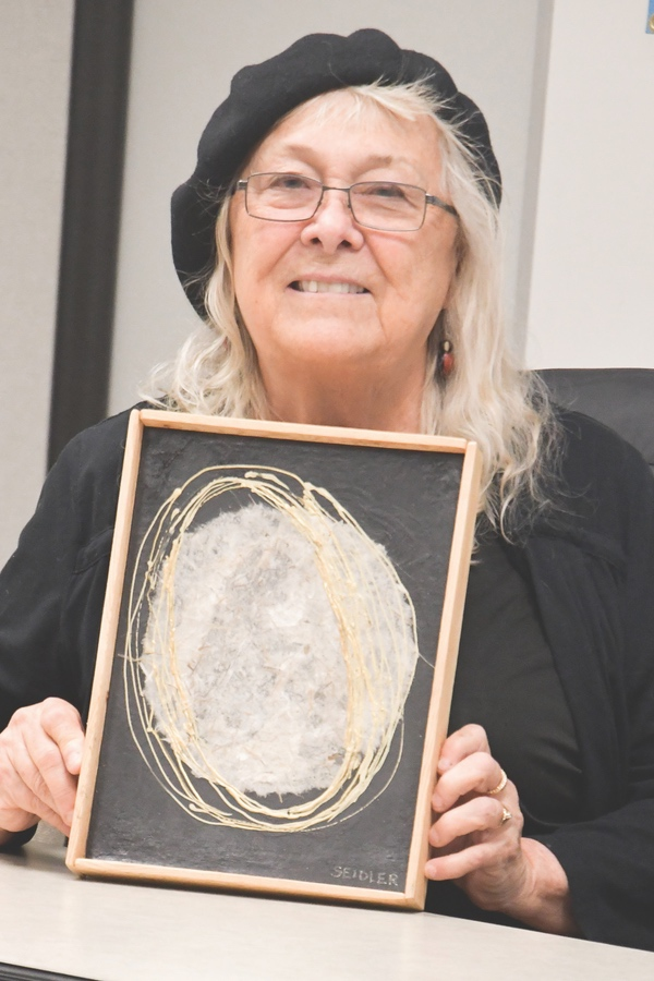 Artist Nancy Seidres with her donated piece for Empty Bowls. (Photo by Christine Such/Sun Day)